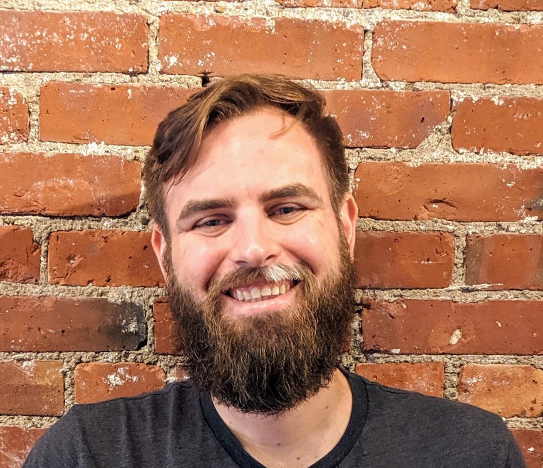 Headshot of Jake Scoggin